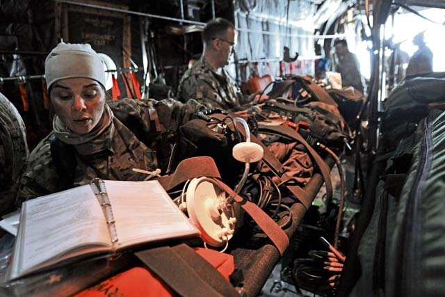 Master Sgt. Jennifer Higgs, 455th Expeditionary Aeromedical Evacuation Squadron technician, conducts an equipment function check inside a C-130 Hercules Feb. 21, 2013, on Bagram Airfield, Afghanistan. The 455th EAES performs its missions on fixed wing aircraft, including the C-17 Globemaster III, C-130 Hercules and KC-135 Stratotanker, and can provide extensive critical care capability with the Critical Care Air Transport Teams.